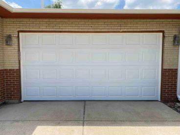Garage door opening height extension